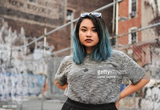 Monica Krystel Rose is seen in Soho wearing a Let Us Prosper top Choies sunglasses and an Md13 necklace on August 31 2015 in New York City