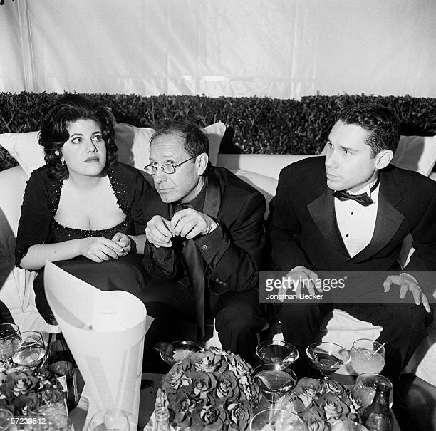 Monica Lewinsky journalist Peter Bart and director Bryan Singer are photographed for Vanity Fair Magazine on March 21 1999 at the Vanity Fair Oscar...