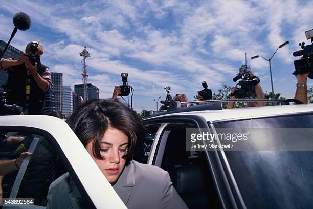 Monica Lewinsky surrounded by photographers as she gets into car. Lewinsky is on her way to the FBI Headquarters.