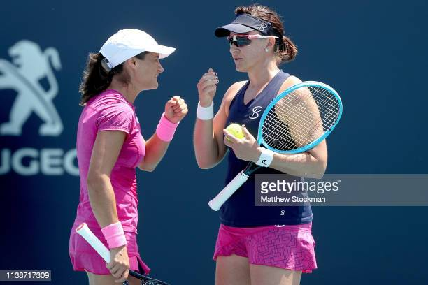 Monica Niculesco of Romania and Abigail Spears play Shuai Zhang of China and Samantha Stosur of Australia during the Miami Open Presented by Itau at...