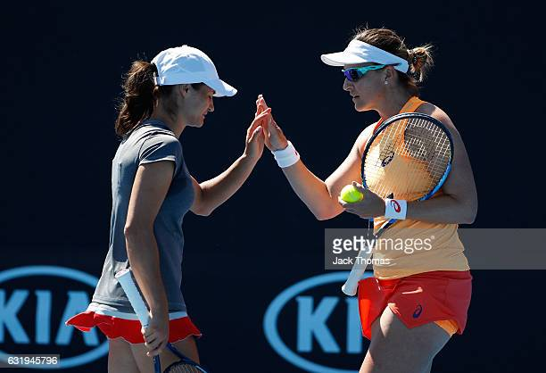 Monica Niculescu of Romania and Abigail Spears of the USA celebrate a point during their first round doubles match against Mirjana LucicBaroni of...