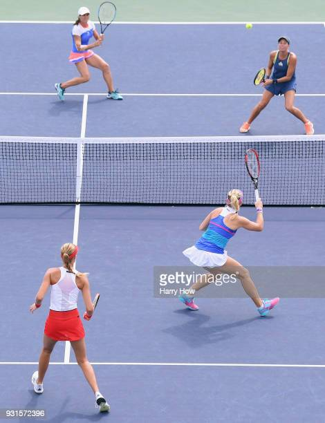 Monica Niculescu of Romania and Andrea Hlavackova of the Czech Republic play Kristina Mladenovic of France and Timea Babos of Hungary during the BNP...