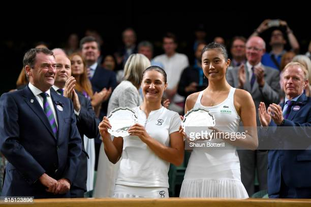Monica Niculescu of Romania and HaoChing Chan of Chinese Taipei pose with their runners up trophies after the Ladies Doubles Final against Ekaterina...