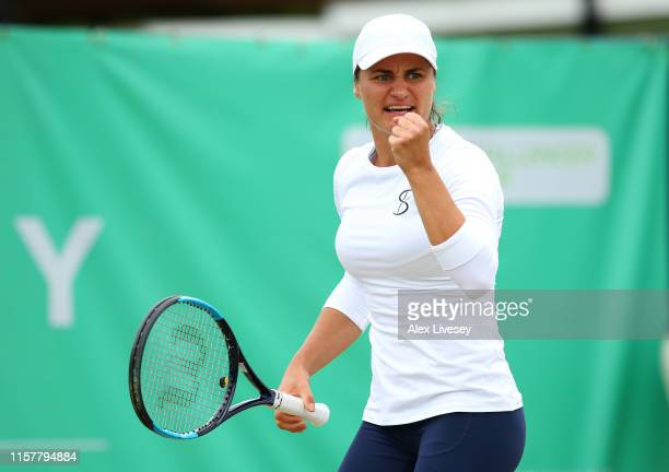 Monica Niculescu of Romania celebrates a point during her victory over Timea Babos of Hungary in the Women's Final at Ilkley Lawn Tennis Squash Club...