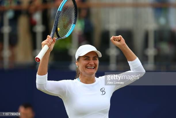 Monica Niculescu of Romania celebrates after match point during her victory over Timea Babos of Hungary during the Women's Final at Ilkley Lawn...