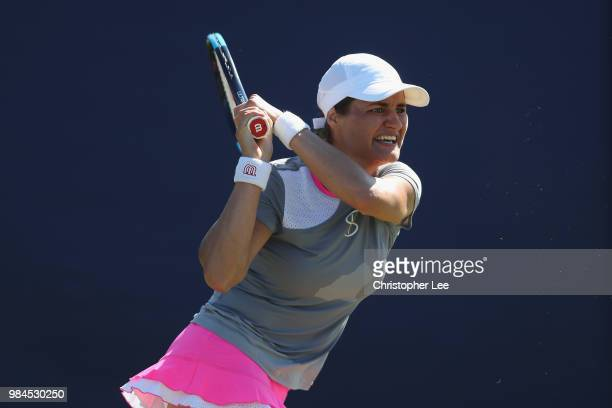 Monica Niculescu of Romania in action against Anna Karolina Schmiedlova of Slovakia in their Round One match during Day One of the Fuzion 100...