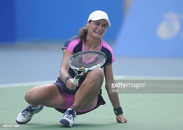 Monica Niculescu of Romania in action during a match against Carla Suarez Navarro of Spain on day three of the 2015 Wuhan Open at Optics Vally...