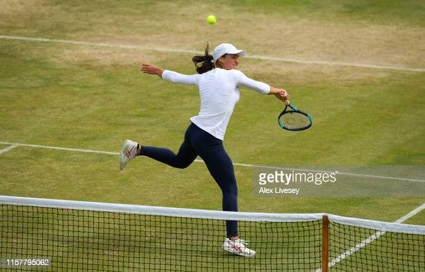 Monica Niculescu of Romania in action during her victory over Timea Babos of Hungary in the Women's Final at Ilkley Lawn Tennis Squash Club on June...