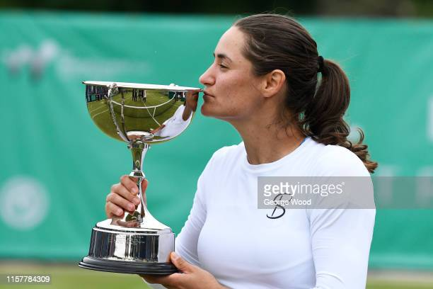 Monica Niculescu of Romania kisses the trophy after winning her women's final against Tímea Babos of Hungary during the Ilkley Trophy Day Seven at...