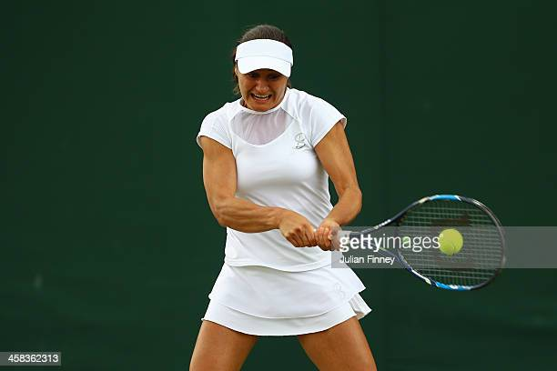 Monica Niculescu of Romania plays a backhand during the Ladies Singles second round match against Timea Bacsinszky of Switzerland on day six of the...