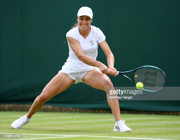 Monica Niculescu of Romania plays a backhand in her Ladies' Singles first round match against Andrea Petkovic of Germany during Day two of The...