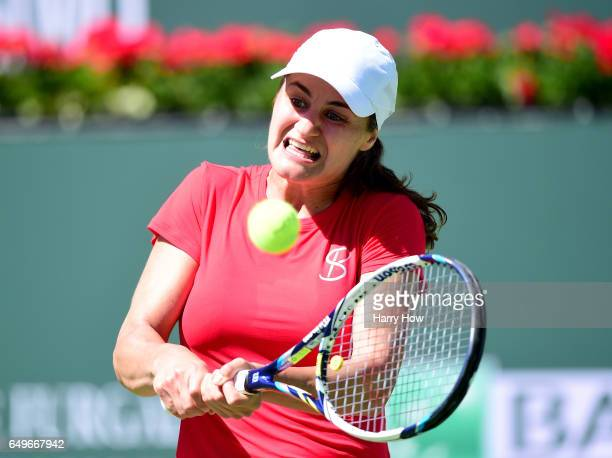 Monica Niculescu of Romania plays a backhand in her match against Sorana Cirstea of Romania during the BNP Parisbas Open at Indian Wells Tennis...
