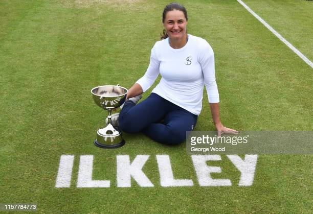 Monica Niculescu of Romania poses for a photo after winning her women's final against Tímea Babos of Hungary during the Ilkley Trophy Day Seven at...