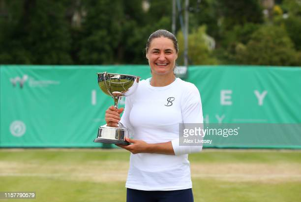 Monica Niculescu of Romania poses with the Ilkley Trophy after her victory over Timea Babos of Hungary during the Women's Final at Ilkley Lawn Tennis...