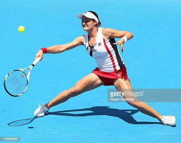 Monica Niculescu of Romania reaches for the ball in her singles match against Anna Chakvetadze of Russia during day one of the 2012 Hobart...