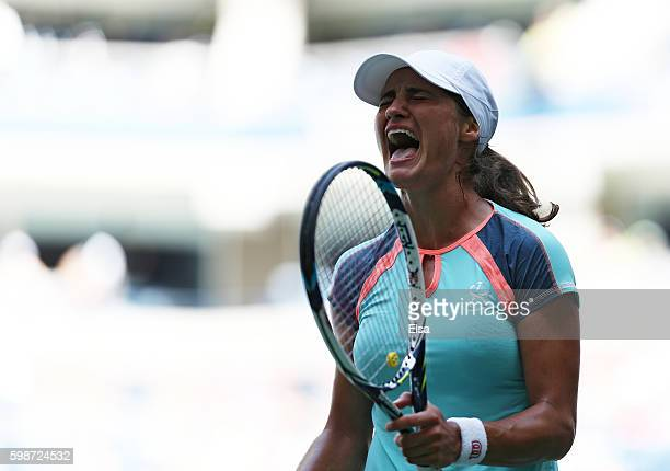 Monica Niculescu of Romania reacts against Caroline Wozniacki of Denmark during her third round Women's Singles match on Day Five of the 2016 US Open...
