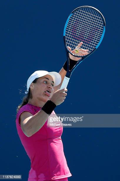 Monica Niculescu of Romania reacts against Garbine Muguruza of Spain during Day 5 of the Miami Open Presented by Itau at Hard Rock Stadium on March...