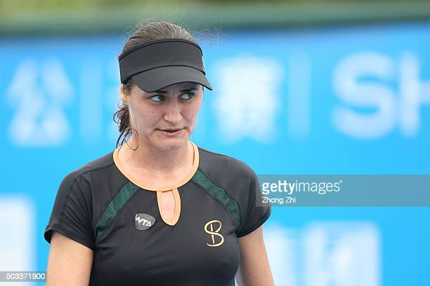 Monica Niculescu of Romania reacts during the match against Anastasija Sevastova of Latvia during Day 2 of 2016 WTA Shenzhen Open at Longgang Sports...