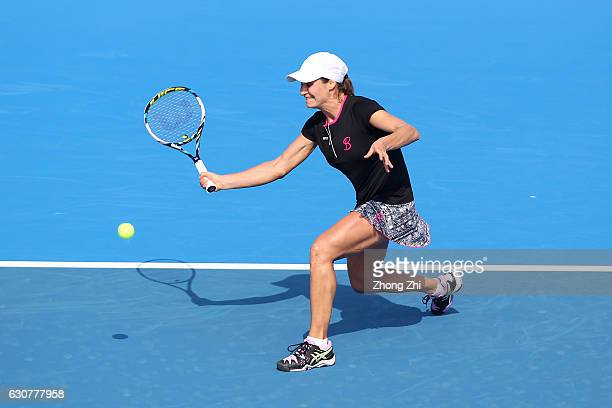 Monica Niculescu of Romania returns a shot during her match against KaiLin Zhang of China during Day 1 of 2017 WTA Shenzhen Open at Longgang...