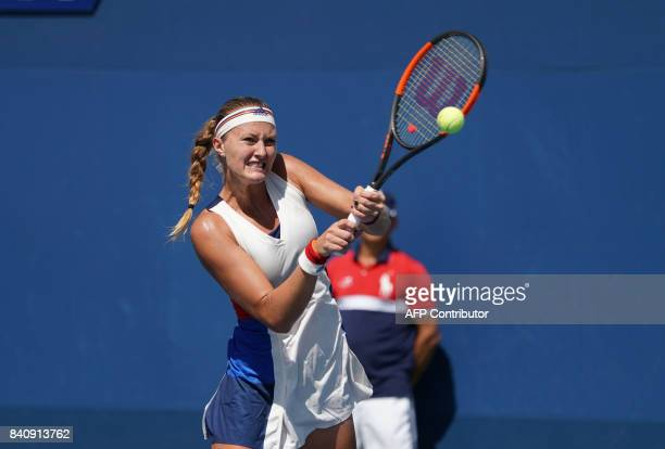 Monica Niculescu of Romania returns the ball to Kristina Mladenovic of France during 2017 US Open Women's Singles match at the USTA Billie Jean King...