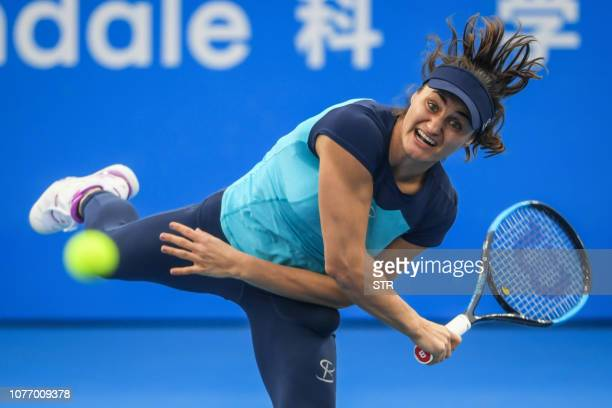 TOPSHOT Monica Niculescu of Romania serves against Wang Yafan of China during their women's singles quarterfinal match at the Shenzhen Open tennis...