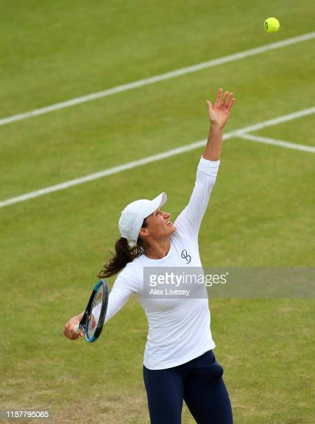 Monica Niculescu of Romania serves during her victory over Timea Babos of Hungary in the Women's Final at Ilkley Lawn Tennis Squash Club on June 23...