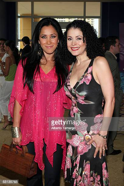 Monica Noguera poses with actress Lourdes Munguia at Encuentro Emociones at the Mandarin Oriental Hotel on June 22 2005 in Miami Florida