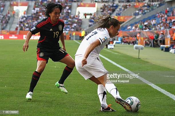 Monica Ocampo of Mexico 8l9 challenges Ali Riley of New Zealand during the FIFA Women's World Cup 2011 Group B match between New Zealand and Mexico...