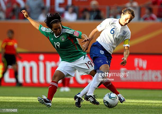 Monica Ocampo of Mexico and Casey Stoney of England battle for the ball during the FIFA Women's World Cup 2011 Group B match between Mexico and...