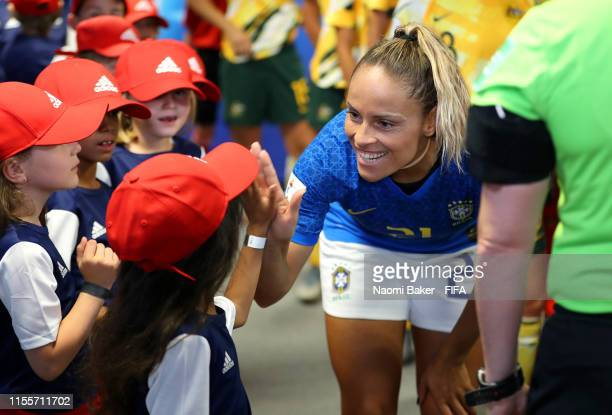 Monica of Brazil speaks with mascots in the tunnel prior to the 2019 FIFA Women's World Cup France group C match between Australia and Brazil at...