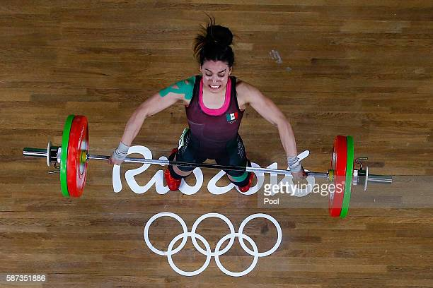 Monica Patricia Dominguez Lara of Mexico competes during the Women's 58kg Group A weightlifting contest on Day 3 of the Rio 2016 Olympic Games at the...