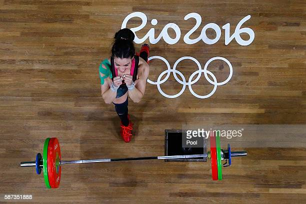 Monica Patricia Dominguez Lara of Mexico reacts during the Women's 58kg Group A weightlifting contest on Day 3 of the Rio 2016 Olympic Games at the...
