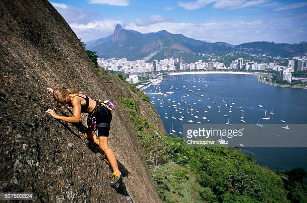 Monica Prazl rock climbing up the Sugar Loaf mountain with views of the Corcovado Botafogo bay and beach and the Yacht club Climbing is a popular...