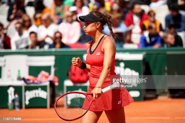 Monica Puig of Peru celebrates during her ladies singles first round match against Kirsten Flipkens of Belgium during Day three of the 2019 French...