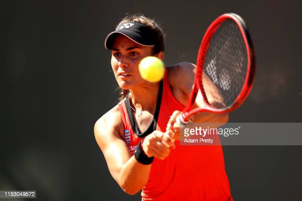 Monica Puig of Peru plays a backhand during her ladies singles third round match against Iga Swiatek of Poland during Day seven of the 2019 French...