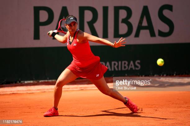 Monica Puig of Peru plays a forehand during her ladies singles first round match against Kirsten Flipkens of Belgium during Day three of the 2019...