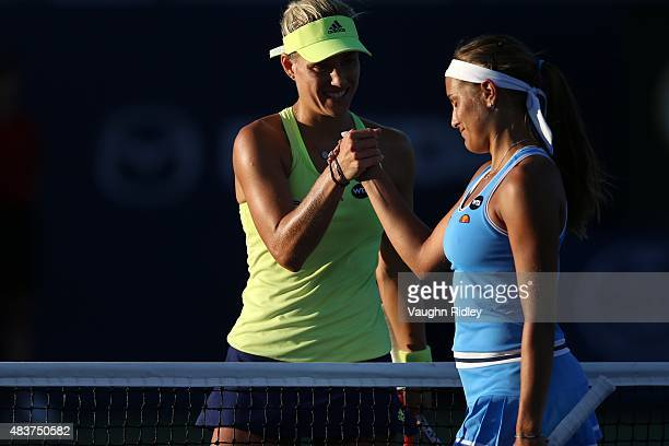 Monica Puig of Puerto Rico and Angelique Kerber of Germany shake hands following their match during Day 3 of the Rogers Cup at the Aviva Centre on...