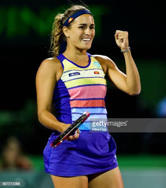 KEY Monica Puig of Puerto Rico celebrates beating Caroline Wozniacki of Denmark 06 64 64 during Day 5 of the Miami Open Presented by Itau at Crandon...