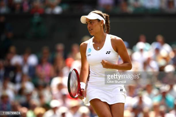 Monica Puig of Puerto Rico celebrates in her Ladies' Singles second round match against Karolina Pliskova of The Czech Republic during Day three of...