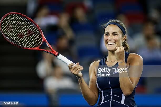 Monica Puig of Puerto Rico celebrates winning her match against Caroline Wozniacki of Denmark during 2018 Wuhan Open at Optics Valley International...