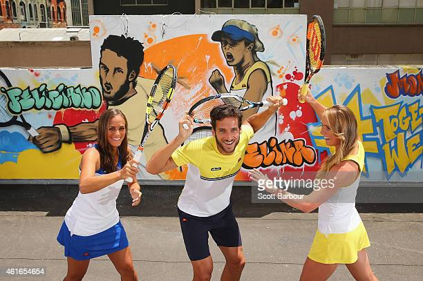 Monica Puig of Puerto Rico Feliciano Lopez of Spain and Elina Svitolina of Ukraine pose after painting street art with Melbourne graffiti artist...