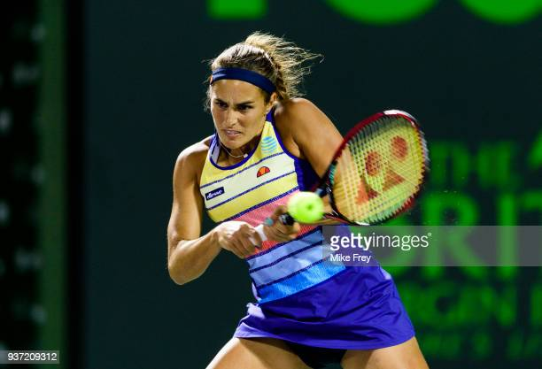 KEY Monica Puig of Puerto Rico hits a backhand to Caroline Wozniacki of Denmark during Day 5 of the Miami Open Presented by Itau at Crandon Park...