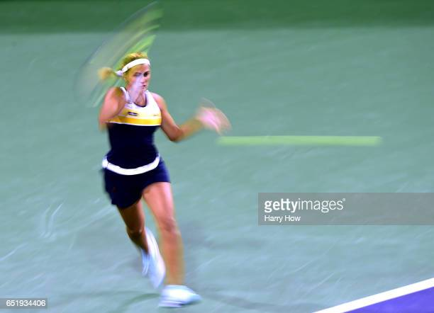 Monica Puig of Puerto Rico hits a forehand in her losing match to Karolina Pliskova of the Czech Republic at Indian Wells Tennis Garden on March 10...