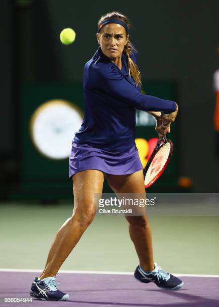 Monica Puig of Puerto Rico in action against Samantha Stosur of Australia in their first round match during the Miami Open Presented by Itau at...
