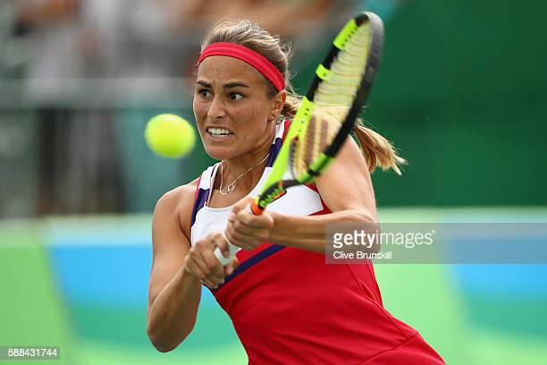 Monica Puig of Puerto Rico plays a backhand during the women's singles quarterfinal match against Laura Siegemund of Germany on Day 6 of the 2016 Rio...