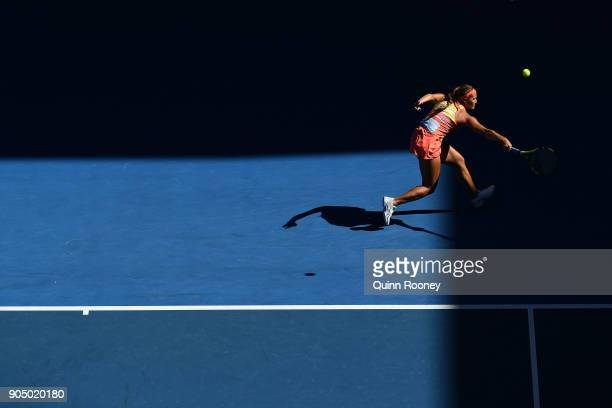 Monica Puig of Puerto Rico plays a backhand in her first round match against Samantha Stosur of Australia on day one of the 2018 Australian Open at...