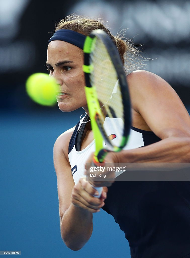 Monica Puig of Puerto Rico plays a backhand in her match against Samantha Stosur of Australia during day four of the Sydney International at Sydney Olympic Park Tennis Centre on January 13, 2016 in Sydney, Australia.