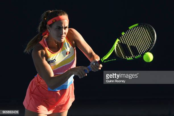 Monica Puig of Puerto Rico plays a backhand in her second round match against Kaia Kanepi of Estonia on day three of the 2018 Australian Open at...