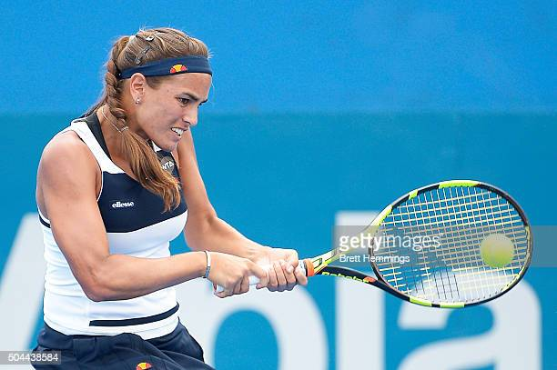 Monica Puig of Puerto Rico plays a backhand shot in her match against Daria Gavrilova of Australia during day two of the 2016 Sydney International at...