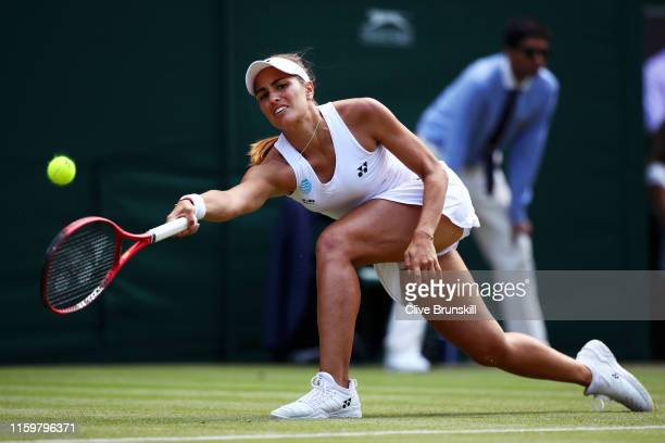 Monica Puig of Puerto Rico plays a forehand in her Ladies' Singles second round match against Karolina Pliskova of The Czech Republic during Day...